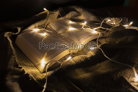 a book illuminated by small lights