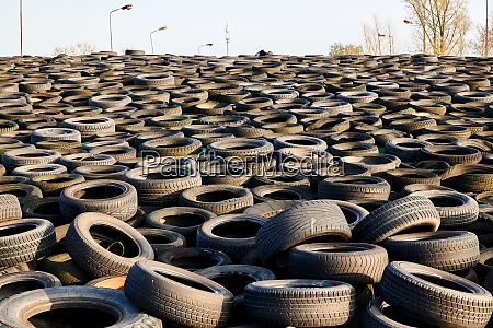 tons of old used tyres in