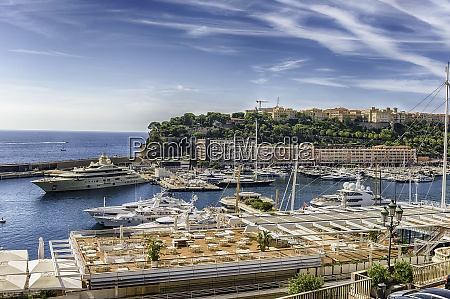 view over luxury yachts and apartments