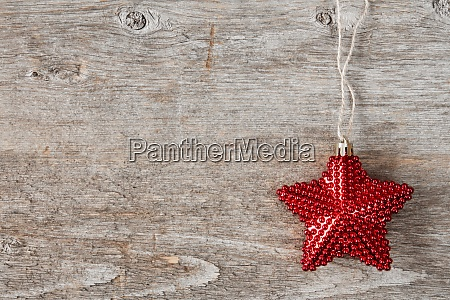 red christmas star on a wooden
