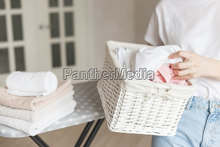 wicker rustic basket with washed clothes