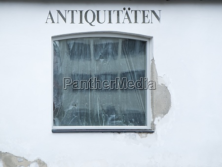 old window of an antique shop