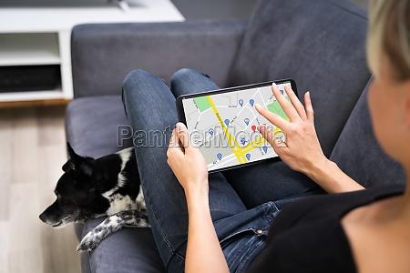 holding gps navigator map on tablet