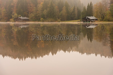 huts at the kirchsee in autumn