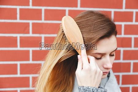 closeup of girl combing beautiful long