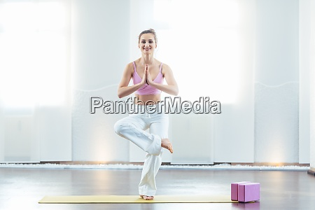 beautiful yoga instructor in her studio