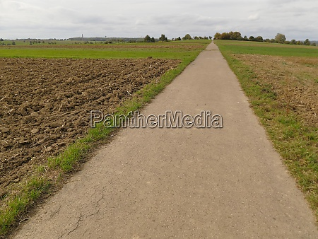 long straight way through plowed fields