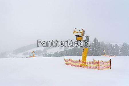 modern snow cannon on a ski