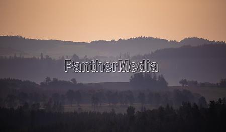fall foggy and misty sunrise landscape