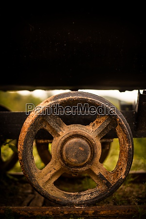 metal wheels of an abandoned wagon