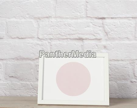 empty white wooden photo frame