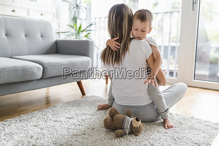 mother and son playing in their