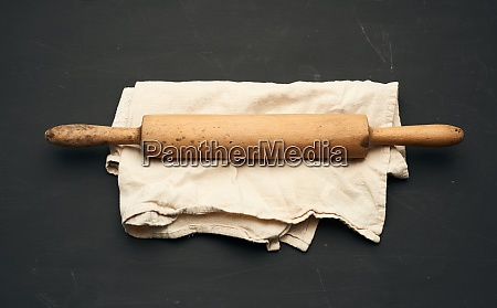 wooden rolling pin lie on a