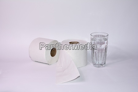 toilet paper rolls with a glass