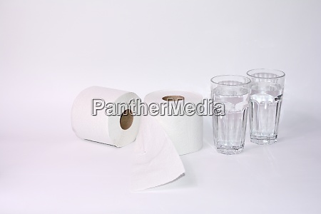 toilet paper rolls with two glasses
