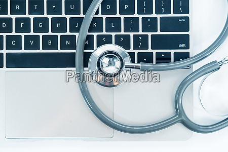 stethoscope for doctor checkup on laptop