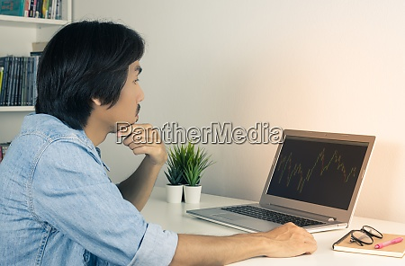 young asian forex trader or investor