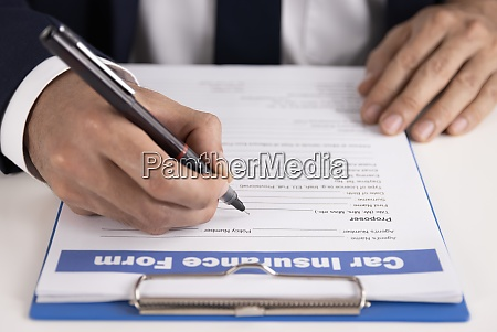 zoom insurance agent hand writing car