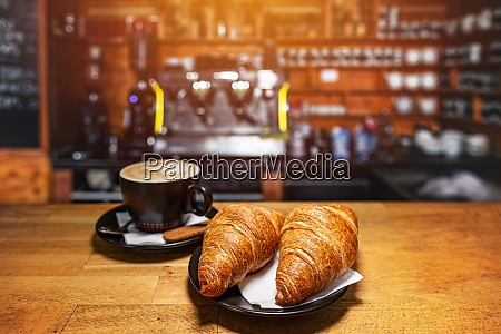 freshly baked croissants and cup of