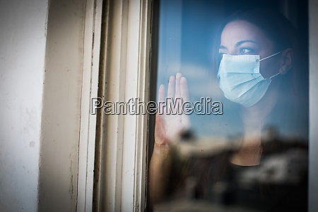 woman wearing a surgical mask by