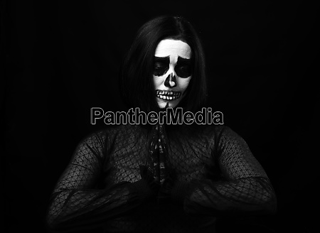 woman with skeleton make up stands