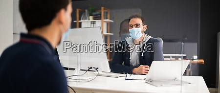 job interview with covid face mask