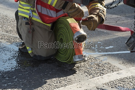 fire hose to extinguish fires and