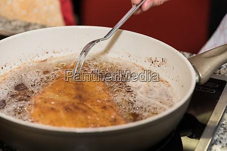 preparing wiener schnitzel close up