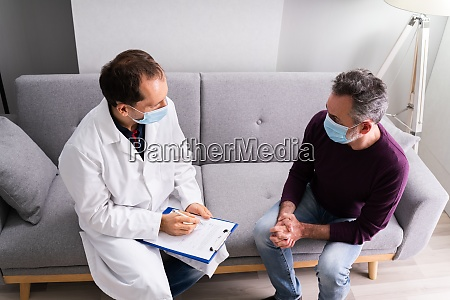 doctor talking to senior patient older