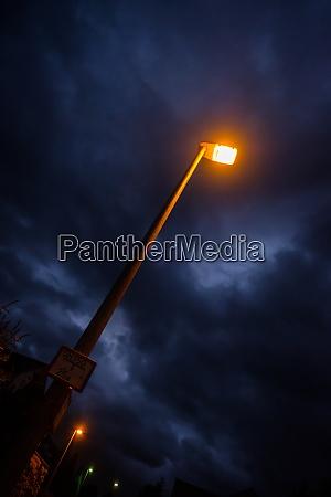 yellow light of a street lamp