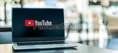laptop computer displaying logo of youtube