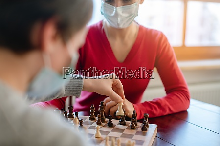 family playing board games during curfew
