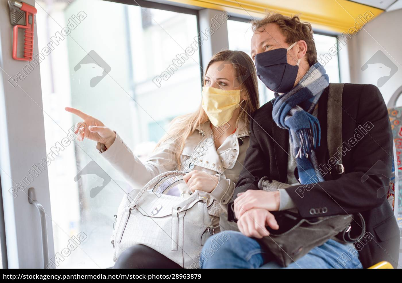 couple, in, public, transport, bus, wearing - 28963879