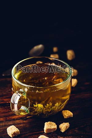 cup of green tea with brown