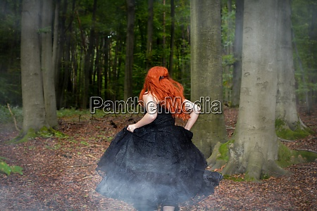 young woman with red hair runs