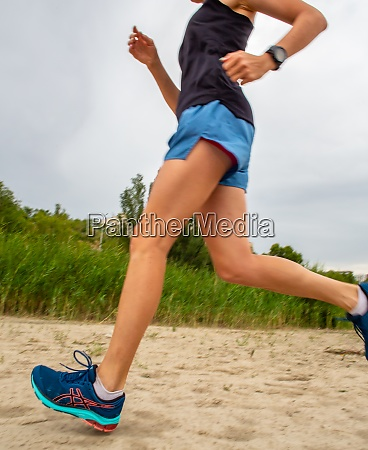 woman jogging down an outdoor trail