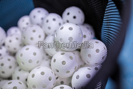 floorball balls in a basket ready