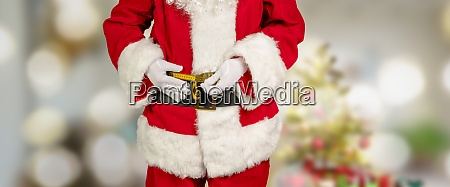 santa measures his stomach circumference with