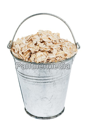bucket with oat flakes