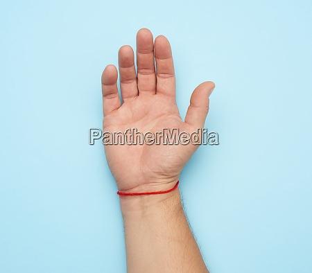 red woolen thread on the wrist