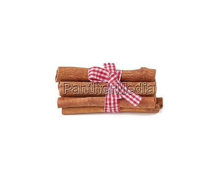 dry cinnamon sticks tied with red