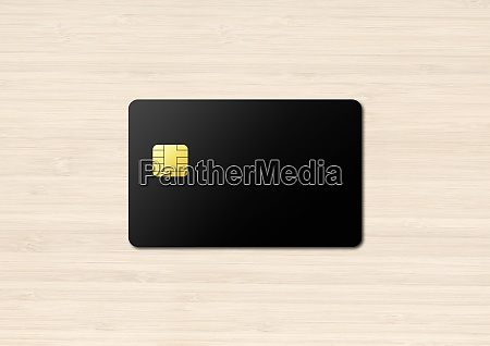 black credit card on a wooden