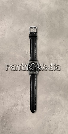 wrist watch isolated on concrete background
