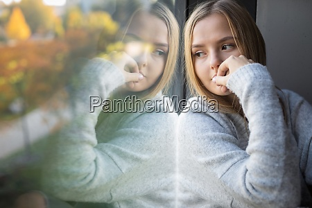 depressedanxious young woman sitting by a