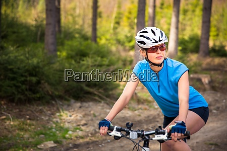 pretty young female biker outdoors on