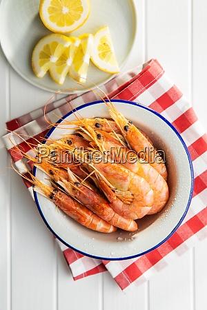 boiled tiger prawns in bowl on
