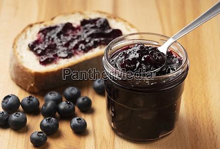 blueberry jam set against a wooden