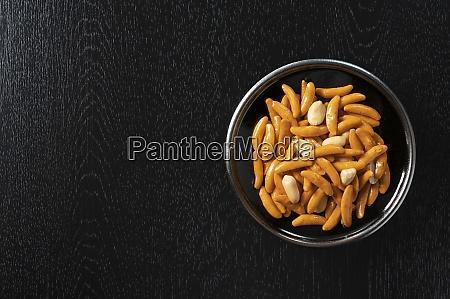 kameda crisps on a black background