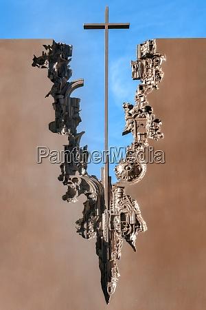 modern sculpture with cross