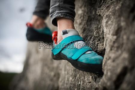 person climbing while wearing rock climbing